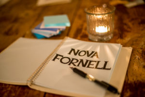 nova-fornell-notebook-and-candle-300x200